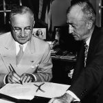 President Truman signs the charter