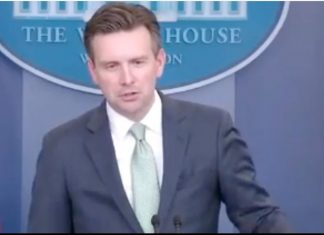 Josh Earnest talking to the press about Buzzfeed's fake news story which Earnest calls news.